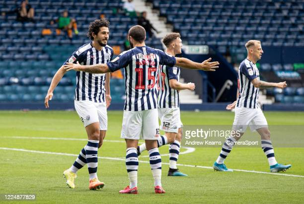 West Bromwich Albion's Ahmed Hegazy celebrates scoring his side's second goal with team mate Charlie Austin during the Sky Bet Championship match...