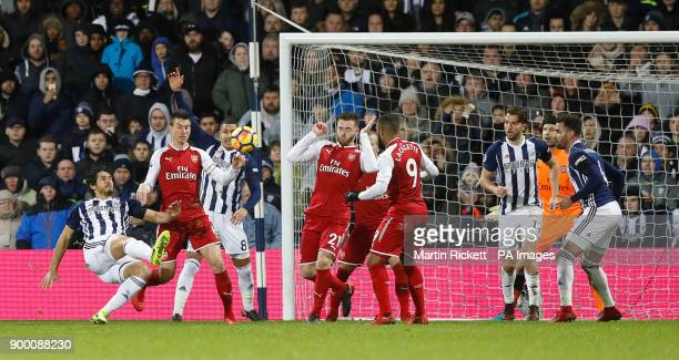 West Bromwich Albion's Ahmed Hegazy shoots during the Premier League match at The Hawthorns West Bromwich