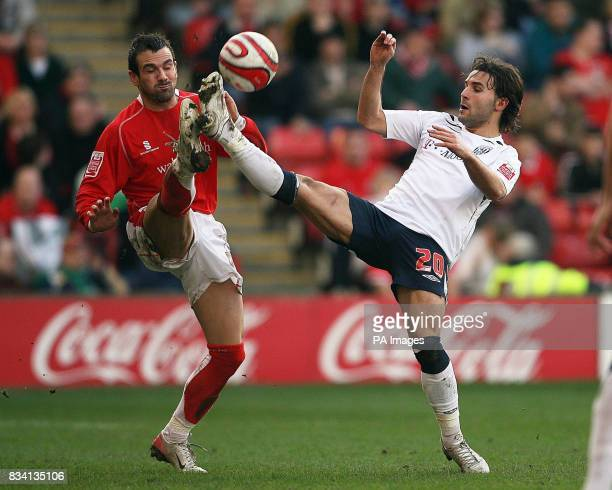 West Bromwich Albion's Andrade Filipe Teixeira and Barnsley's Martin Devaney battle for the ball during the CocaCola Championship match at Oakwell...