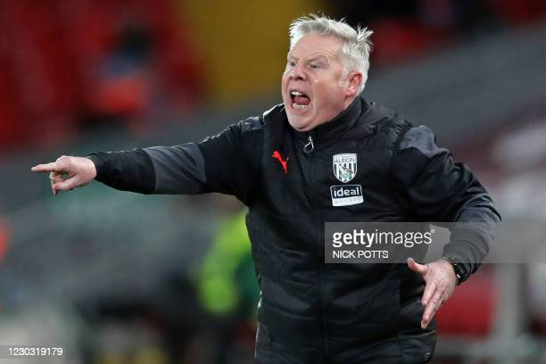 West Bromwich Albion's assistant head coach Sammy Lee gestures on the touchline during the English Premier League football match between Liverpool...