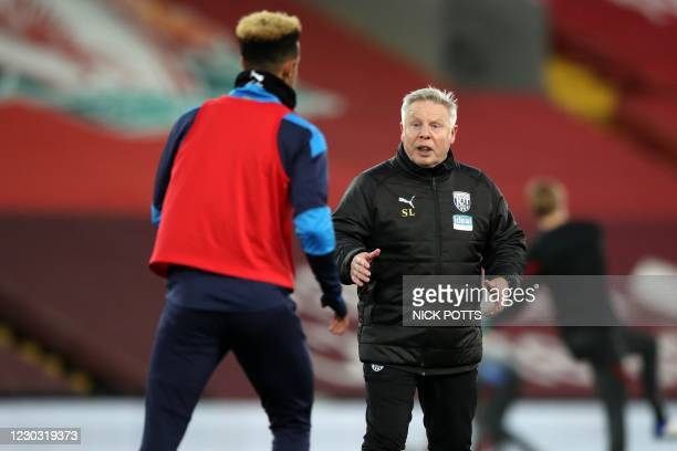 West Bromwich Albion's assistant head coach Sammy Lee speaks with West Bromwich Albion's English striker Callum Robinson during warm up ahead of the...