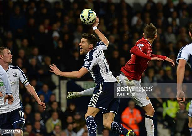 West Bromwich Albion's Belgian defender Sebastien Pocognoli survives this call for handball during the English Premier League football match between...
