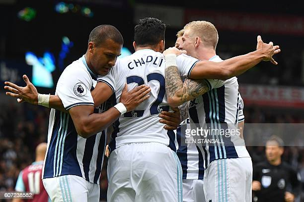 West Bromwich Albion's Belgian midfielder Nacer Chadli celebrates after scoring a penalty for the opening goal during the English Premier League...