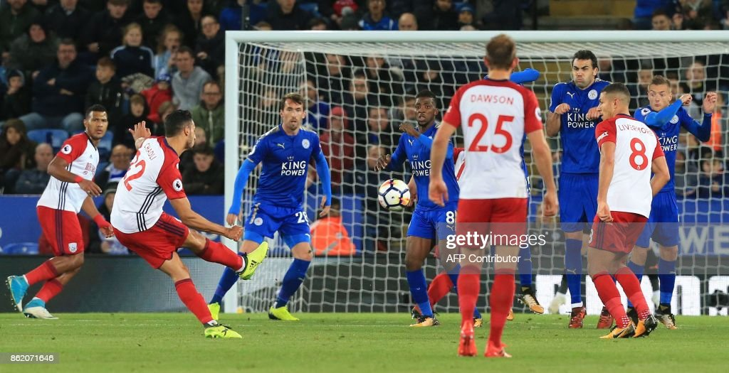 West Bromwich Albion's Belgian midfielder Nacer Chadli (2L) scores his team's first goal during the English Premier League football match between Leicester City and West Bromwich Albion at King Power Stadium in Leicester, central England on Octopber 16, 2017. / AFP PHOTO / Lindsey PARNABY / RESTRICTED TO EDITORIAL USE. No use with unauthorized audio, video, data, fixture lists, club/league logos or 'live' services. Online in-match use limited to 75 images, no video emulation. No use in betting, games or single club/league/player publications. /