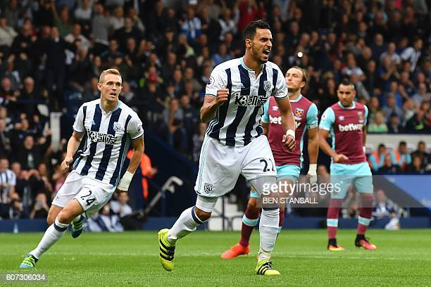 West Bromwich Albion's Belgian midfielder Nacer Chadli scoring a penalty for the opening goal during the English Premier League football match...