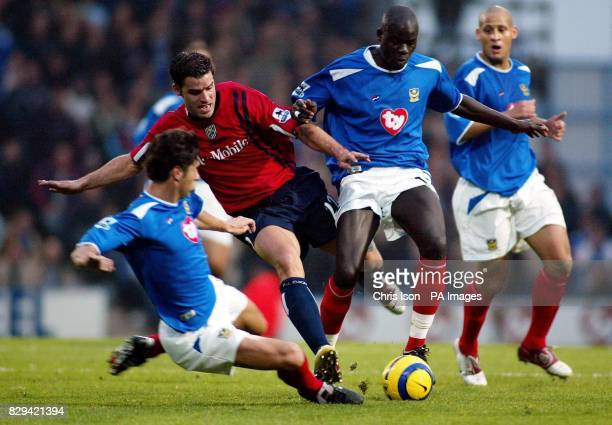 West Bromwich Albion's Bernt Haas is edged out by Portsmouth's Dejan Stefanovic and Amdy Faye during their Barclays Premiership match at Fratton...