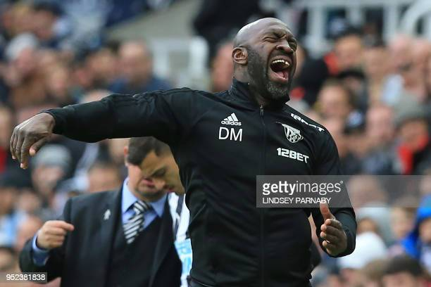 West Bromwich Albion's caretaker manager Darren Moore gestures on the touchline during the English Premier League football match between Newcastle...