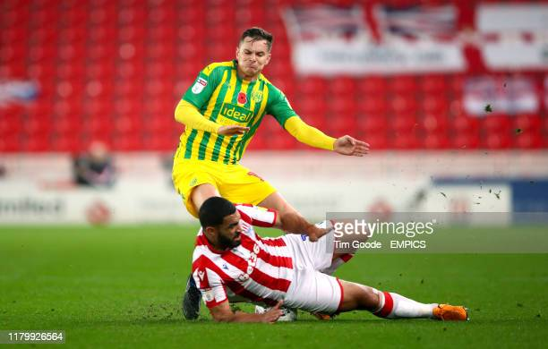 West Bromwich Albion's Conor Townsend and Stoke City's Cameron Carter-Vickers battle for the ball Stoke City v West Bromwich Albion - Sky Bet...