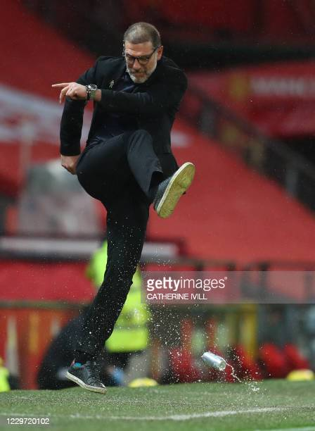 West Bromwich Albion's Croatian head coach Slaven Bilic kicks a drinks can during the English Premier League football match between Manchester United...