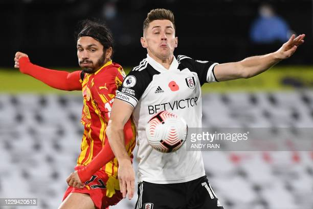 West Bromwich Albion's Croatian midfielder Filip Krovinovic vies with Fulham's English midfielder Tom Cairney during the English Premier League...