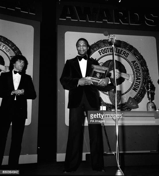 West Bromwich ALBION'S CYRILLE REGIS WITH HIS TROPHY AT THE LONDON HILTON HOTEL AFTER BEING NAMED YOUNG PLAYER OF THE YEAR AS KEVIN KEEGAN LOOKS ON