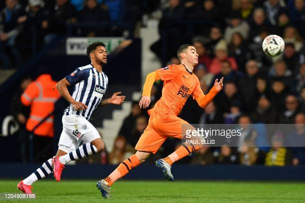West Bromwich Albion's Darnell Furlong vies with Newcastle United's Paraguayan midfielder Miguel Almiron during the English FA Cup fifth round...