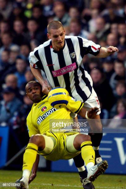 West Bromwich Albion's Darren Purse holds off Charlton Athletic's Shaun Bartlett