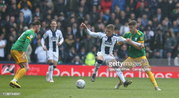 West Bromwich Albion's Dwight Gayle shields the ball from Preston North End's Jordan Storey during the Sky Bet Championship match between West...
