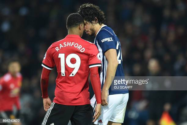 West Bromwich Albion's Egyptian defender Ahmed Hegazy clashes with Manchester United's English striker Marcus Rashford during the English Premier...