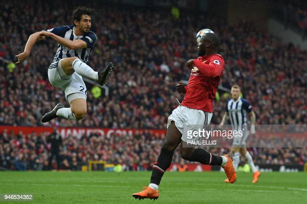 West Bromwich Albion's Egyptian defender Ahmed Hegazy clears the ball during the English Premier League football match between Manchester United and...