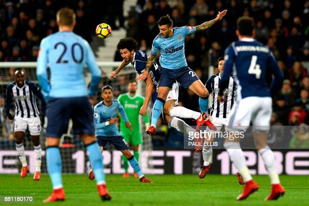West Bromwich Albion's Egyptian defender Ahmed Hegazy jumps against Newcastle United's Irish defender Ciaran Clark during the English Premier League...