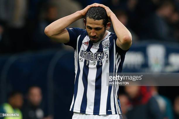 West Bromwich Albion's Egyptian defender Ahmed Hegazy reacts after the English Premier League football match between West Bromwich Albion and Swansea...