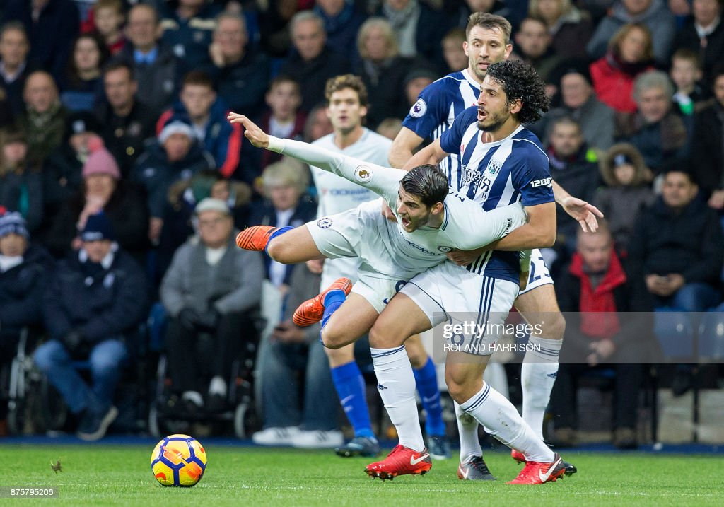 TOPSHOT - West Bromwich Albion's Egyptian defender Ahmed Hegazy (R) vies with Chelsea's Spanish striker Alvaro Morata (C) during the English Premier League football match between West Bromwich Albion and Chelsea at The Hawthorns stadium in West Bromwich, central England, on November 18, 2017. PHOTO / Roland Harrison / RESTRICTED TO EDITORIAL USE. No use with unauthorized audio, video, data, fixture lists, club/league logos or 'live' services. Online in-match use limited to 75 images, no video emulation. No use in betting, games or single club/league/player publications. /