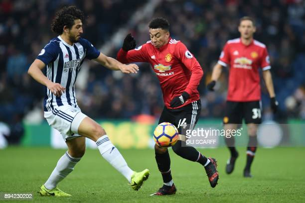 West Bromwich Albion's Egyptian defender Ahmed Hegazy vies with Manchester United's English midfielder Jesse Lingard during the English Premier...