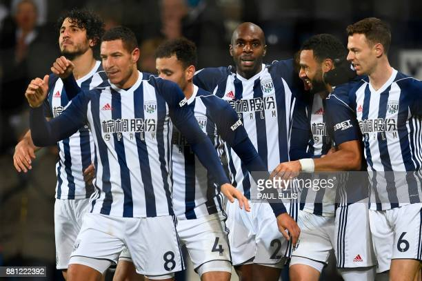 West Bromwich Albion's Egyptian defender Ahmed Hegazy West Bromwich Albion's English midfielder Jake Livermore West Bromwich Albion's Englishborn...