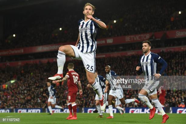West Bromwich Albion's English defender Craig Dawson celebrates after scoring his later disallowed after a VAR consultation goal during the English...