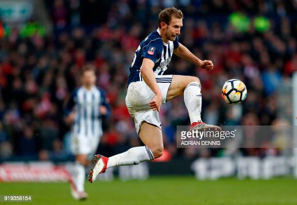 West Bromwich Albion's English defender Craig Dawson controls the ball during the English FA Cup fifth round football match between West Bromwich...