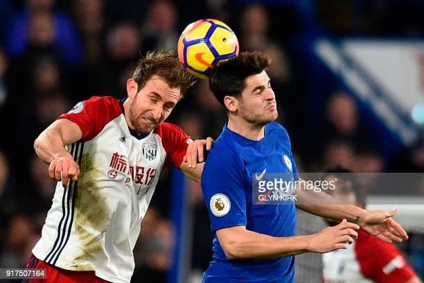 West Bromwich Albion's English defender Craig Dawson jumps against Chelsea's Spanish striker Alvaro Morata during the English Premier League football...