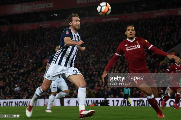 West Bromwich Albion's English defender Craig Dawson prepares to cross the ball in the build up to their third goal during the English FA Cup fourth...
