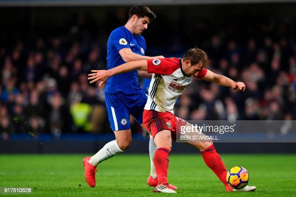 West Bromwich Albion's English defender Craig Dawson tries to hold off Chelsea's Spanish striker Alvaro Morata during the English Premier League...