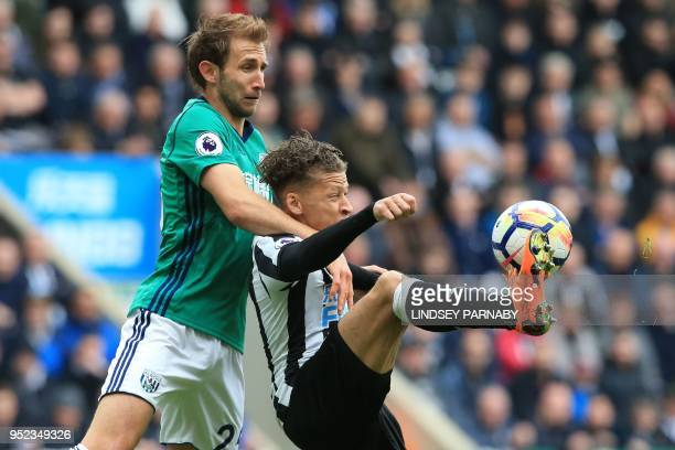 West Bromwich Albion's English defender Craig Dawson vies with Newcastle United's English striker Dwight Gayle during the English Premier League...