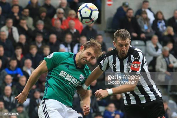 West Bromwich Albion's English defender Craig Dawson vies with Newcastle United's French midfiielder Florian Lejeune during the English Premier...