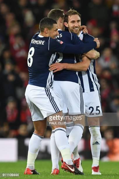 West Bromwich Albion's English defender Craig Dawson West Bromwich Albion's Northern Irish defender Jonny Evans and West Bromwich Albion's English...