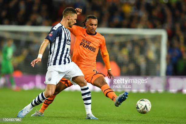 West Bromwich Albion's English defender Kieran Gibbs vies with Newcastle United's Austrian midfielder Valentino Lazaro during the English FA Cup...