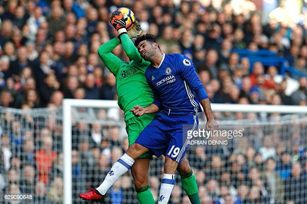 West Bromwich Albion's English goalkeeper Ben Foster catches the ball under pressure from Chelsea's Brazilian-born Spanish striker Diego Costa during...