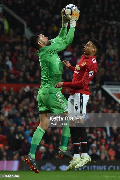 West Bromwich Albion's English goalkeeper Ben Foster catches the ball in front of Manchester United's English midfielder Jesse Lingard during the...