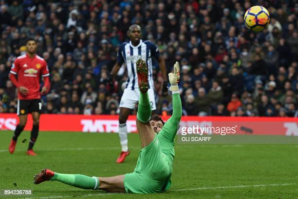 West Bromwich Albion's English goalkeeper Ben Foster is unable to prevent Manchester United's English midfielder Jesse Lingard's deflected shot...