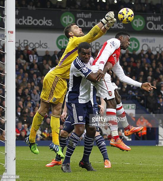 West Bromwich Albion's English goalkeeper Ben Foster punches the ball clear over the head of West Bromwich Albion's English defender Andre Wisdom...