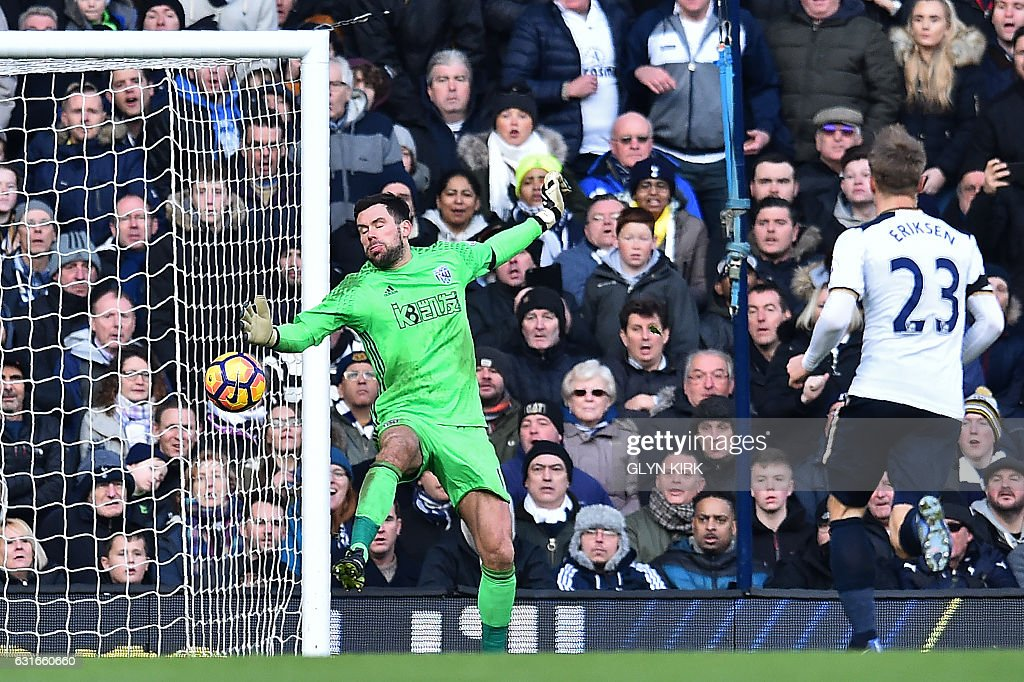 West Bromwich Albion's English goalkeeper Ben Foster (L) reacts as he fails to save a shot from Tottenham Hotspur's English striker Harry Kane, resulting in a fourth goal for Tottenham, during the English Premier League football match between Tottenham Hotspur and West Bromwich Albion at White Hart Lane in London, on January 14, 2017. / AFP / Glyn KIRK / RESTRICTED TO EDITORIAL USE. No use with unauthorized audio, video, data, fixture lists, club/league logos or 'live' services. Online in-match use limited to 75 images, no video emulation. No use in betting, games or single club/league/player publications. /