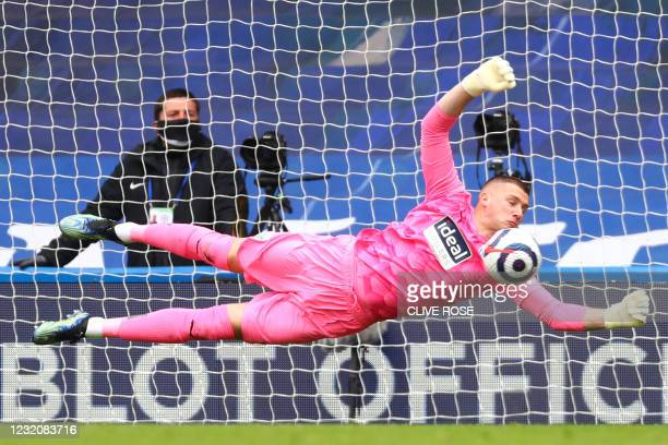 West Bromwich Albion's English goalkeeper Sam Johnston dives to save a free kick during the English Premier League football match between Chelsea and...