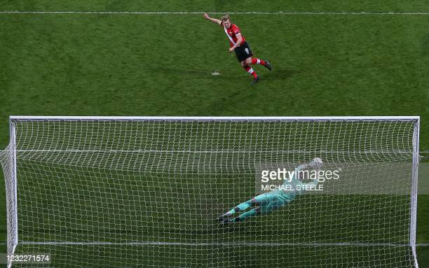 West Bromwich Albion's English goalkeeper Sam Johnston saves this late penalty kick from Southampton's English midfielder James Ward-Prowse during...