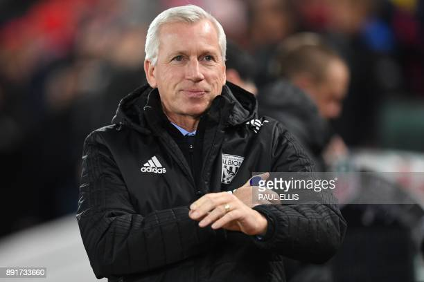 West Bromwich Albion's English head coach Alan Pardew arrives for the English Premier League football match between Liverpool and West Bromwich...