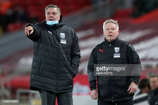 West Bromwich Albion's English Head Coach Sam Allardyce and West Bromwich Albion's assistant head coach Sammy Lee watch from the touchline during the...