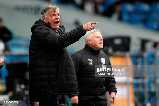 West Bromwich Albion's English head coach Sam Allardyce and West Bromwich Albion's assistant head coach Sammy Lee gesture on the touchline during the...