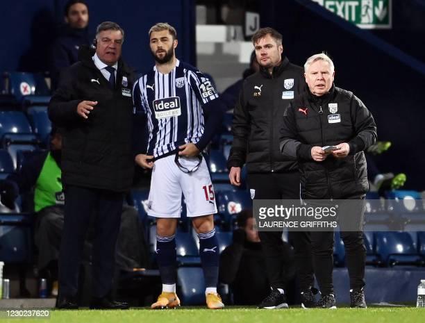 West Bromwich Albion's English Head Coach Sam Allardyce brings on West Bromwich Albion's English striker Charlie Austin during the English Premier...