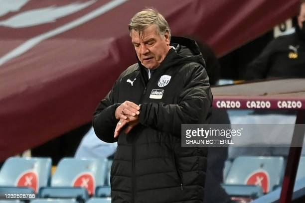 West Bromwich Albion's English head coach Sam Allardyce checks his watch late in the game during the English Premier League football match between...