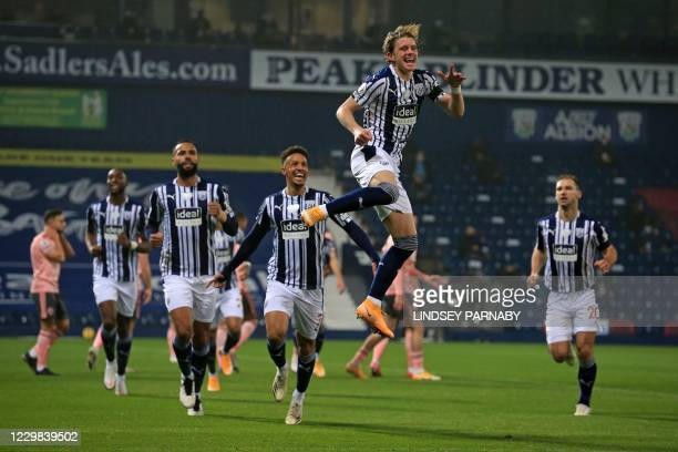 West Bromwich Albion's English midfielder Conor Gallagher celebrates scoring the opening goal during the English Premier League football match...
