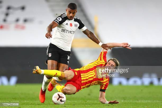 West Bromwich Albion's English midfielder Conor Gallagher tackles Fulham's Gabonese midfielder Mario Lemina during the English Premier League...