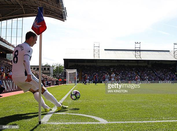 West Bromwich Albion's English midfielder Craig Gardner takes a corner during the English Premier League football match between Crystal Palace and...