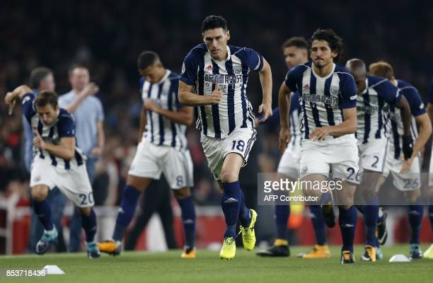 West Bromwich Albion's English midfielder Gareth Barry runs on the pitch for his 633rd Premier League appearance the English Premier League football...